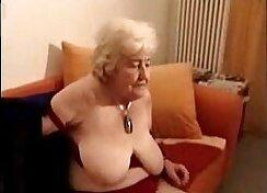 Amateur slut masturbates on a red couch part