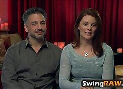 Couple fucking on a swinger bar