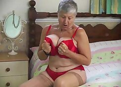 blond mature with huge tits masturbating
