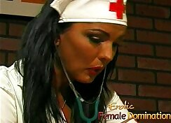 Busty hotel nurse seduces client with strapon on table